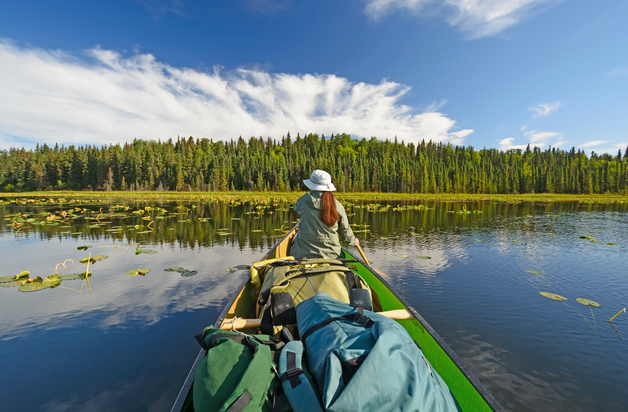 woman in a canoe on the water