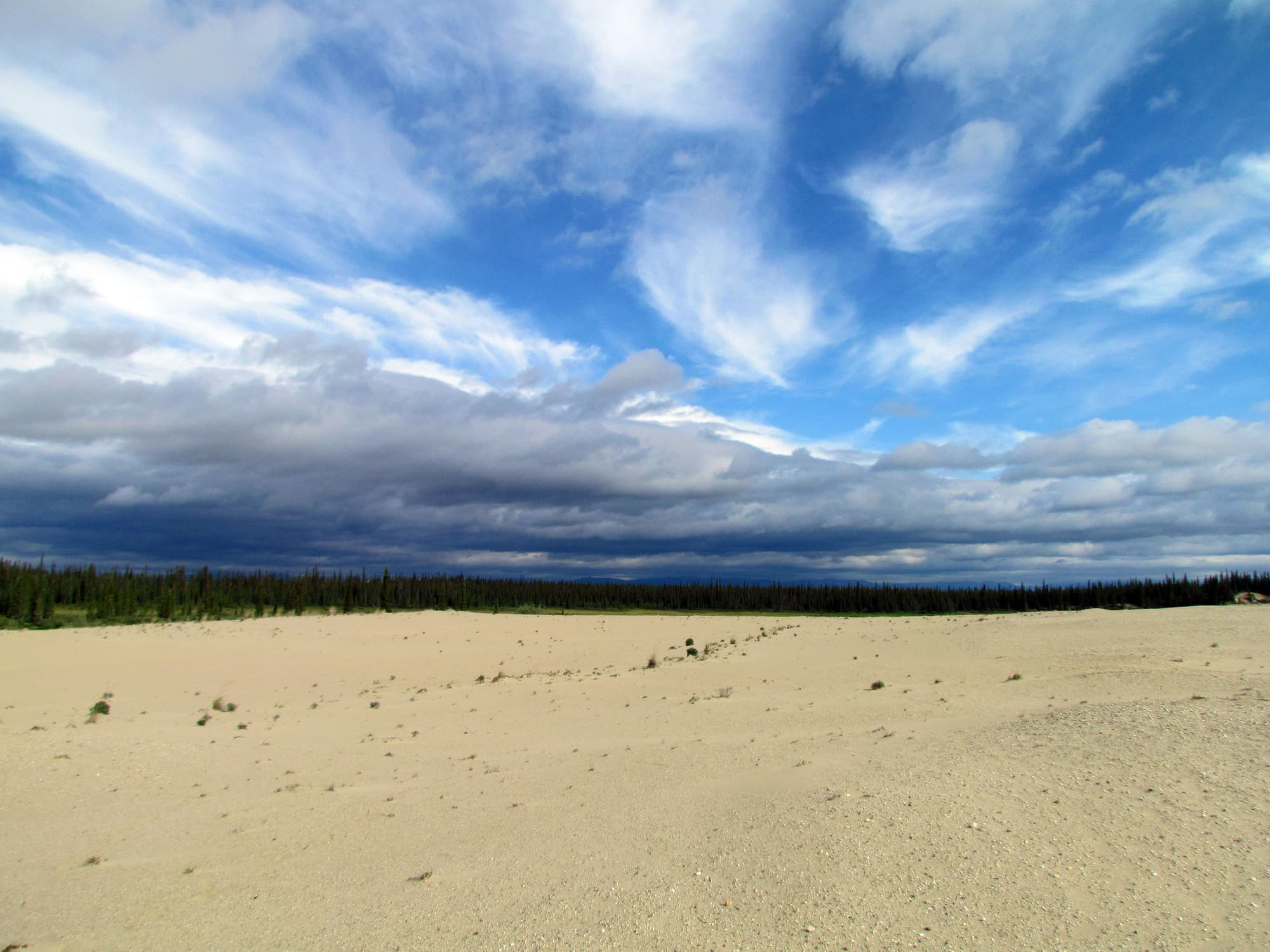 clouds over sand dunes