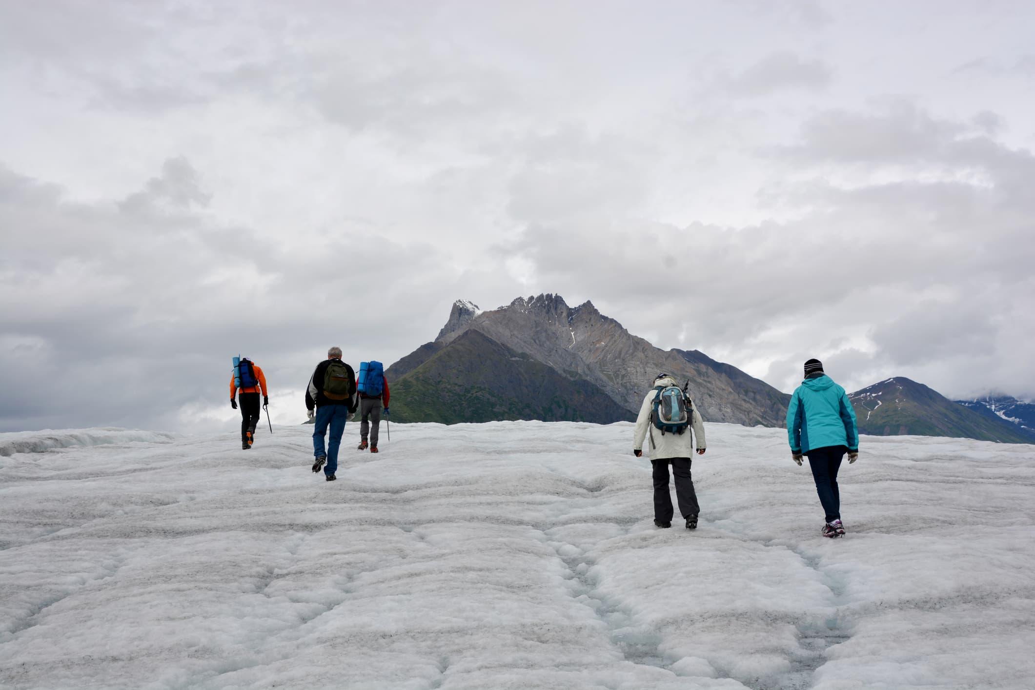 People Hiking up a Glacier