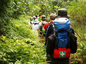 Group Hiking with Back Packs and an Emergency Aid Kit