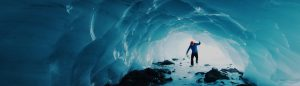 Man walking in an ice cave