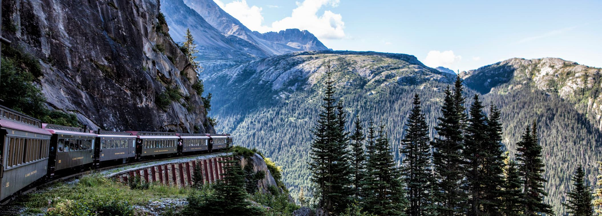 train travelling around a mountain pass